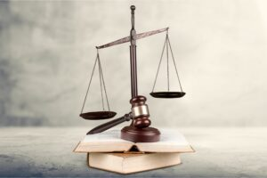 Scales of Justice with gavel and books