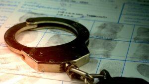 handcuff laying on fingerprint sheets