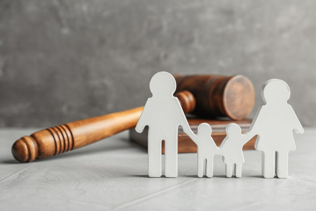 Gavel and small model of family holding hands representing child custody lawyers
