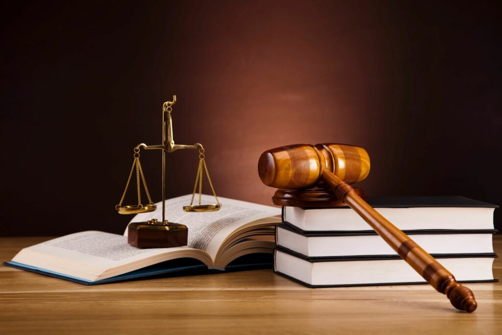 gavel and scales of justice on stack of books